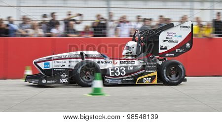 HOCKENHEIM, GERMANY - AUGUST 1, 2015: Team AMZ from ETH Zurich during the accelleration event at Formula Student Germany. The current world record holder's car accellerates from 0 to 100 km/h in 2,1s.