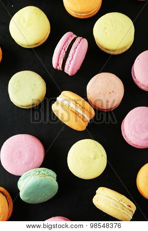 French Colorful Macarons On Black Background