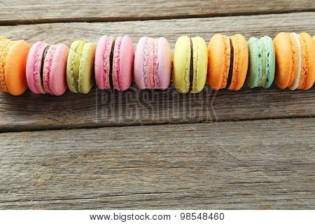 French Colorful Macarons On Grey Wooden Background