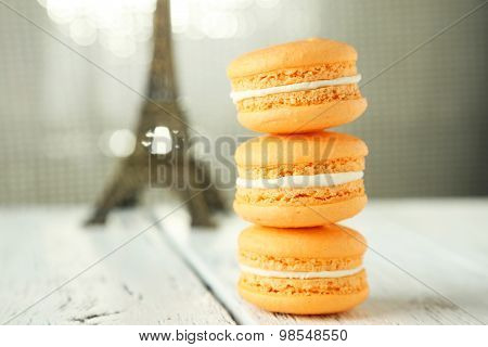 French Orange Macarons On White Wooden Background