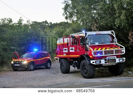 Fire Trucks At The Entrance Of A Forest Road