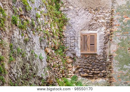 Old Window On The Ancient Wall
