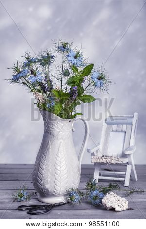 Antique jug filled with wild flowers