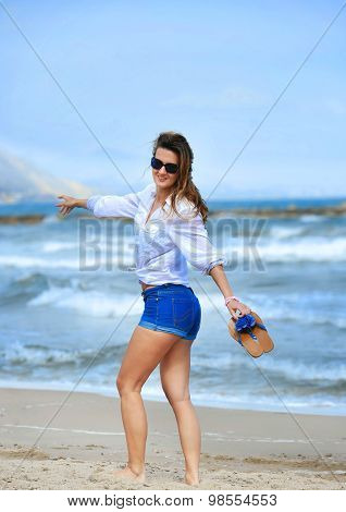 Attractive Woman In Shorts Walking Happy On Beach Sand Wearing S