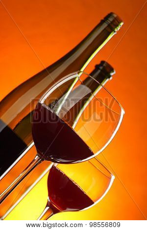 Red wine - still-life with glasses and bottles. Tilted composition.