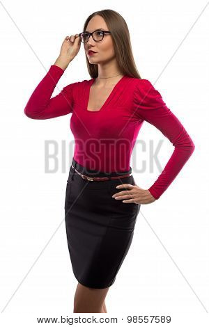 Photo of woman in red shirt touching glasses