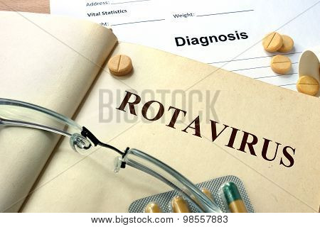 Word Rotavirus  on a paper and pills.