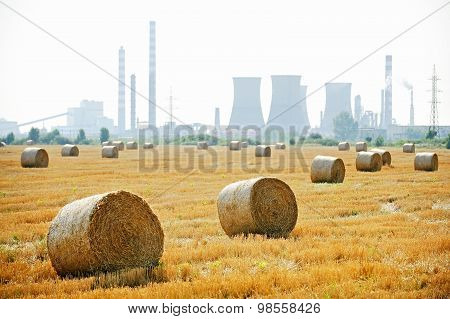 Hay Bales With Petrochemical Plant On Background
