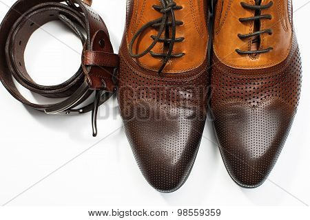 Isolated Stylish Leather Men's Dress Shoes And Belt