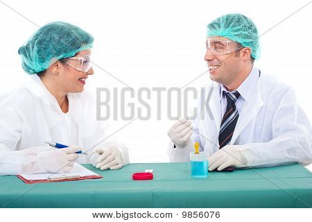 Team Of Scientists Having Conversation