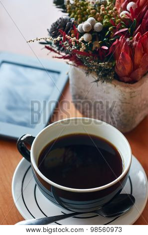 warm cup java coffee on table with plant
