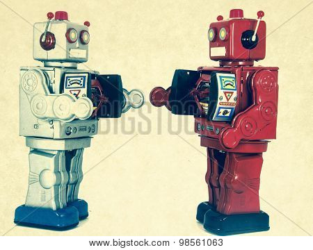 two robots looking at each other
