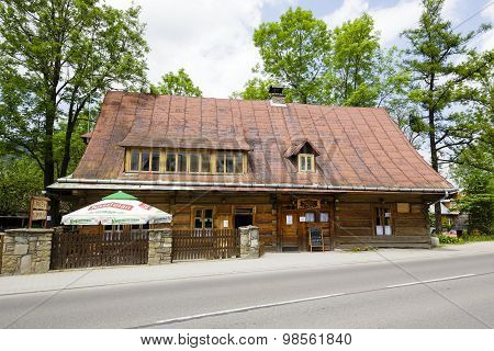 Old Wooden House Made Of Wooden Logs