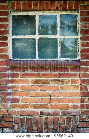 Old red brick wall with closed window