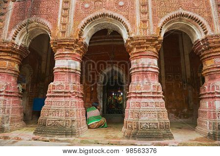 Woman prays at the Pancharatna Govinda Hindu temple in Puthia, Bangladesh.