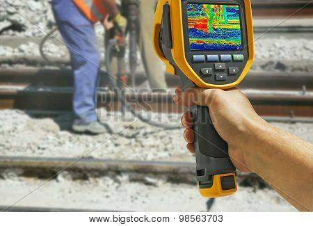 Recording With Infrared Camera Two Workers