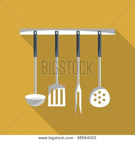 Kitchen Tools On A Hanger With Long Shadow.