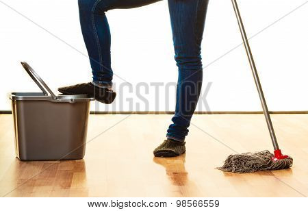 Legs Of Cleaning Woman With Mop Bucket