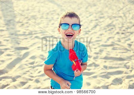 Happy Little Boy With Pinwheel