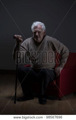 Senior Man Using Walking Stick