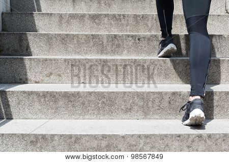 Female Running Up Stairs