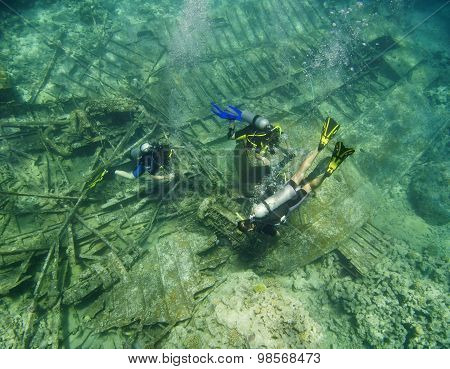 Scuba Divers Exploring An Underwater Wreck