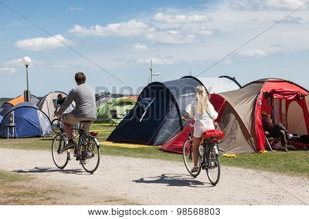 Couple With Bicycles On A Camping
