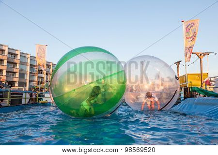Kids In Bubbles Floating On The Water