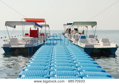 Floating Pier And Empty Pleasure Watercraft