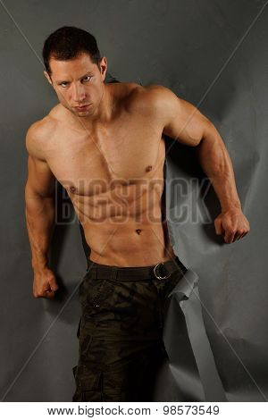 Muscular man ripped paper