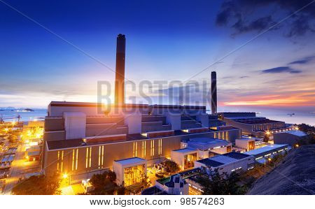 Glow light of petrochemical industry on sunset