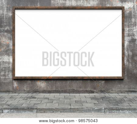Blank advertising billboard with rusty frame on a dirty grunge wall.