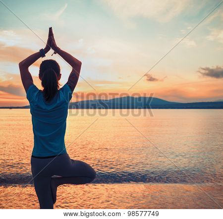 Woman Doing Yoga Exercise In Pose Of Tree