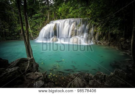 Clear water pond and silky waterfall in forest