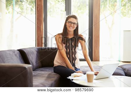 Portrait Of Businesswoman Having Working Lunch In Office