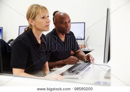 Engineers Using CAD System In Design Studio