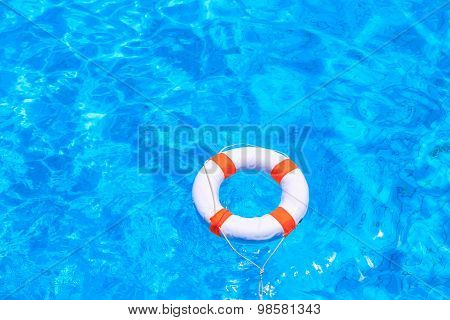 Life Buoy Floating In A Swimming Pool