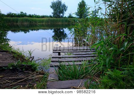 Wooden Bridge on river at evening time
