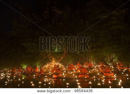 Chiang Mai, Thailand - July 30: Unidentified Thai Monks Meditate Around Buddha Statue Among Many Can