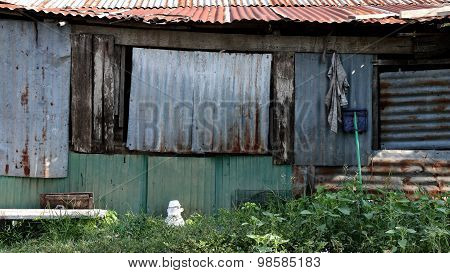 Side of Old Building In Slum