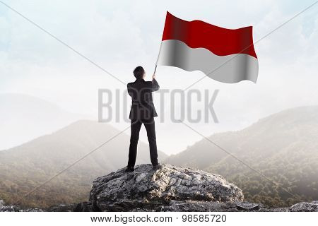 Successful Man Waving Indonesian Flag