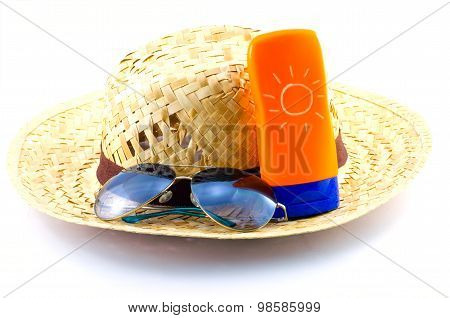 Hat With Sunglasses And Body Lotion On White Background