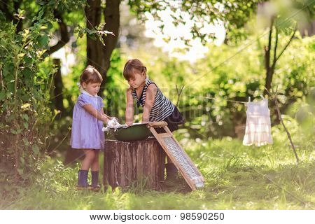 Little Helper Girls Sisters Washes Clothes Using The Washboard Outdoors