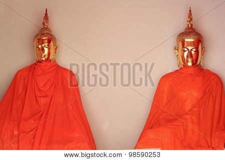 Statue Of Buddha Wearing In Orange Sacred Fabric Clothing Called The Robe
