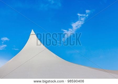 Top Of White Canvas Tent Against Clear Blue Sky Background.