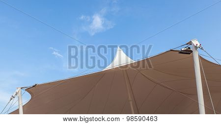 Looking Up At The Top Of White Tent Against Clear Blue Sky Background.