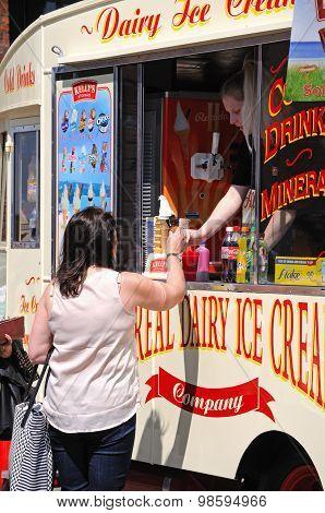 Tourist buying ice cream, Liverpool.