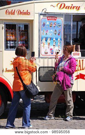 Tourists by ice cream van, Liverpool.