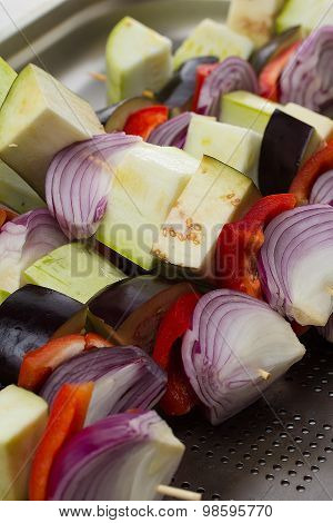 Raw Vegetables Skewer On A Plate Over Wooden Background