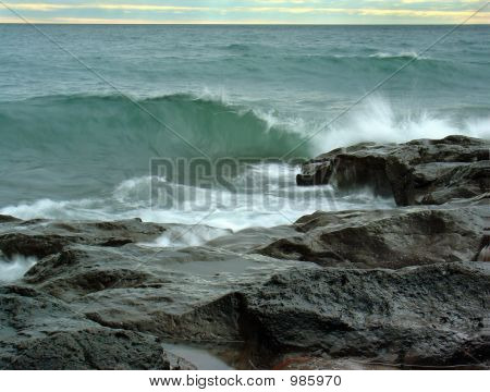 Lake Shore Rocks And Waves